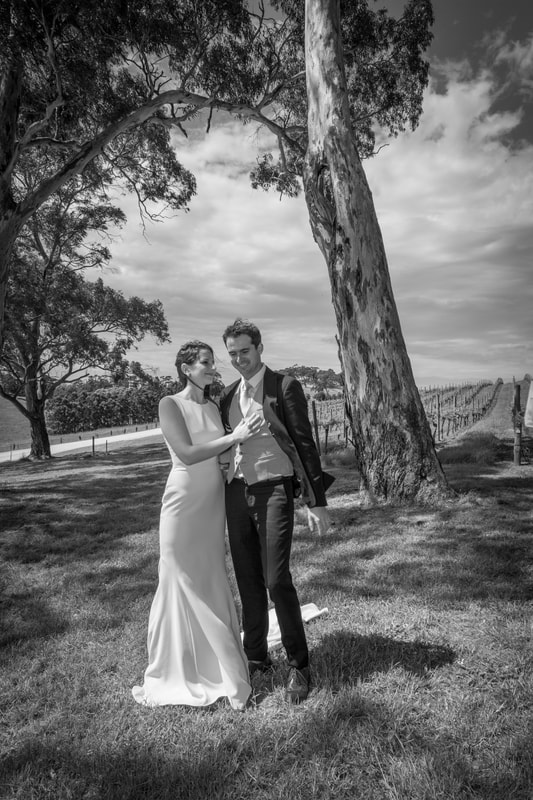 Black and white photo of the bride and groom holding each other after the wedding ceremony in Adelaide.